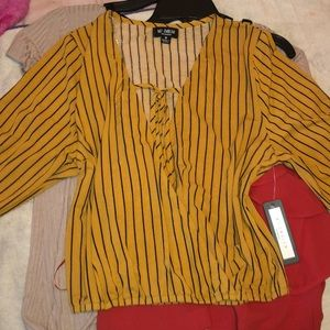 Yellow and black strips shirt v neck style